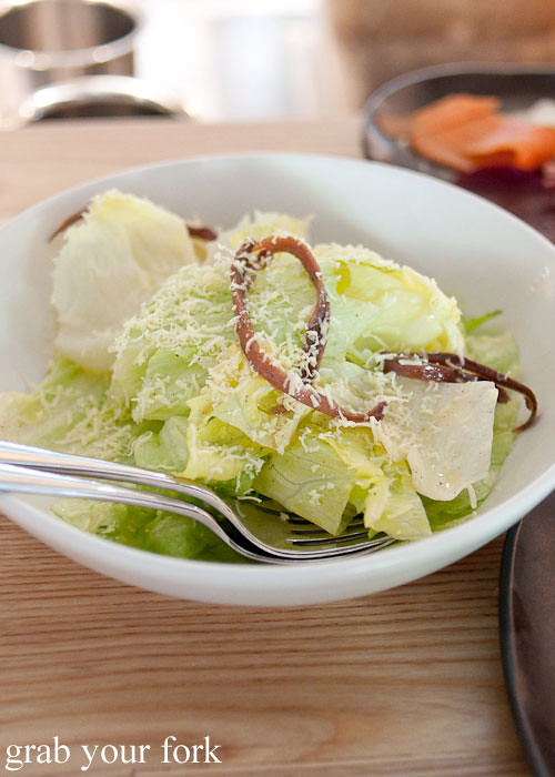 iceberg lettuce with ortiz anchovy and haloumi
