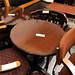 Low circular mahogony bar table