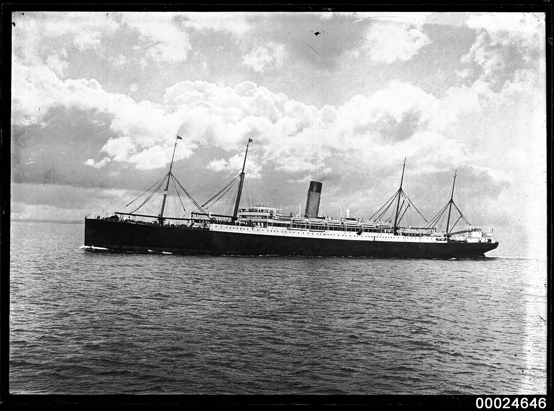 Starboard view of a White Star Line passenger steamship, probably SS CERAMIC, at sea
