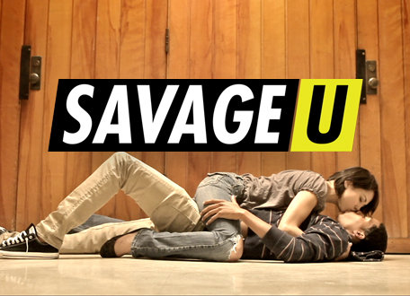 "A woman and man lay on the floor of a gymnasium, making out. The text above them, in black, white and yellow lettering reads ""Savage U."""