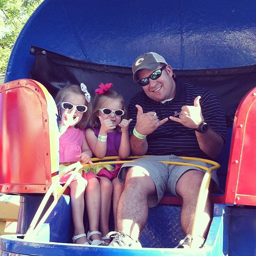 These three love the Tilt a Whirl. None for me, thanks!