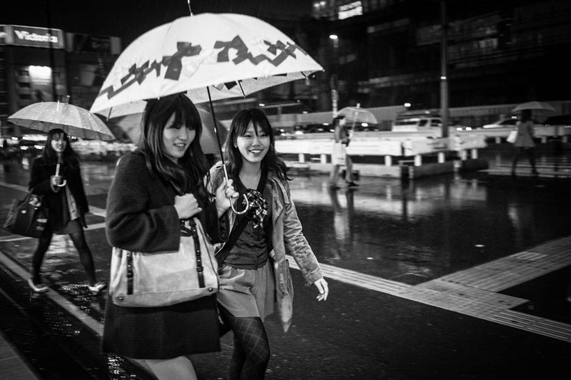 Sharing an umbrella in Shinjuku.