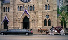 Horse, carriage, limo, and church