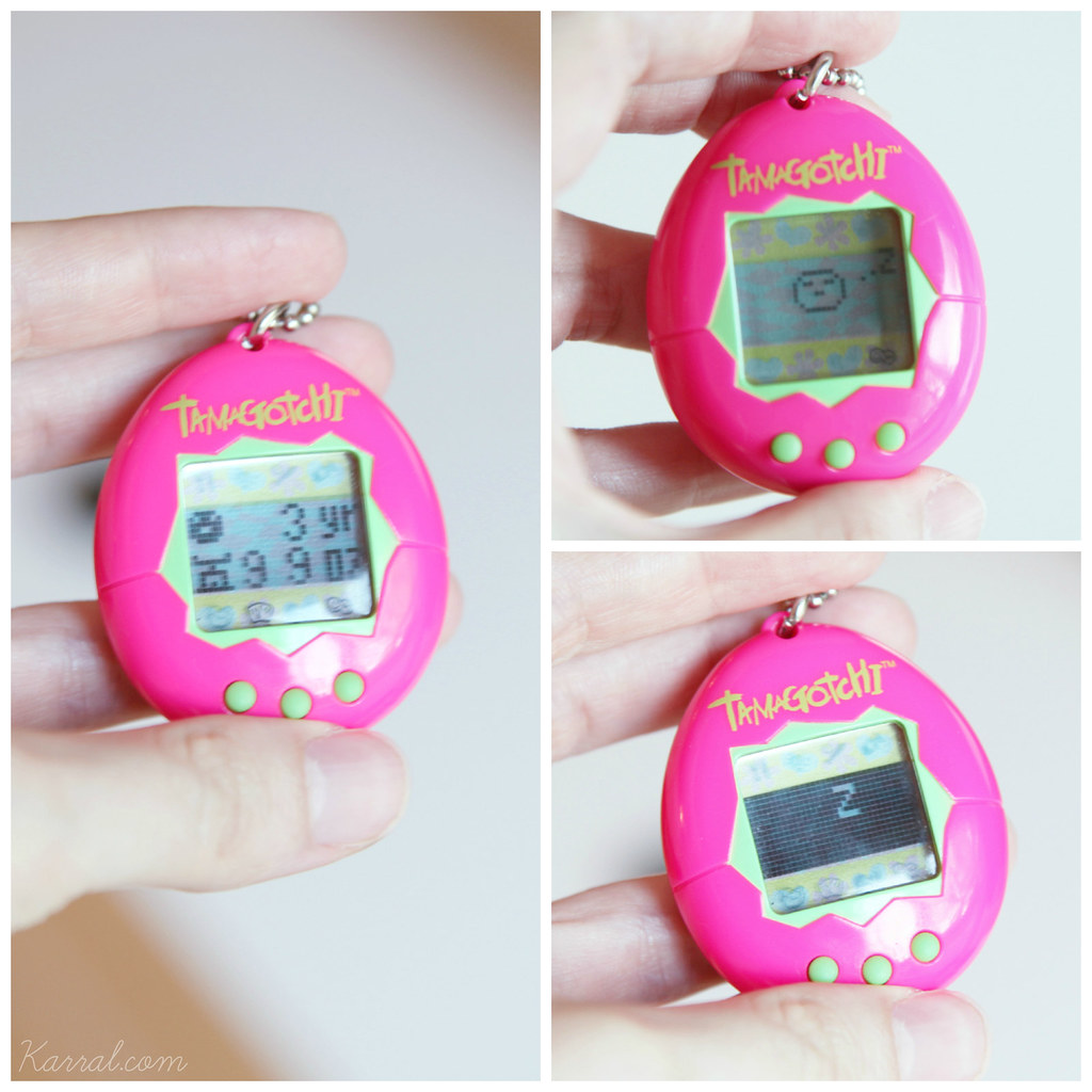 neon pink & green shell Tamagotchi V1 original 1997 by Bandai - here in Marutchi baby child stage at the end of third day - 3 years old + sleeping asleep screen lights off