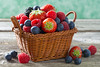basket with fresh juicy berries