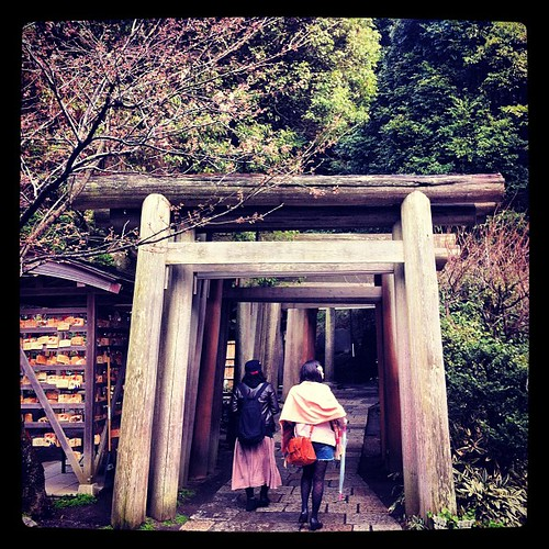 Two girls walking into an endless #tunnel of a #japanese #shrine