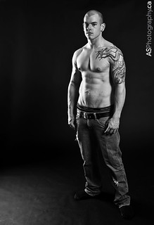 Buff and tattoo in jeans.