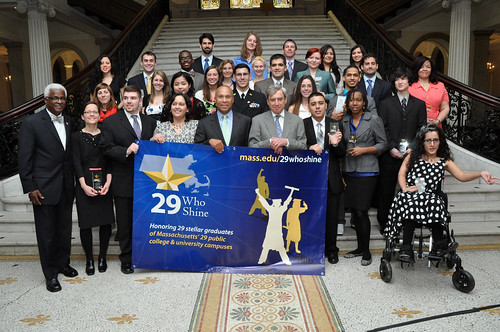 "Commissioner Freeland and the ""29 Who Shine"" students gather in front of the Massachusetts State House"