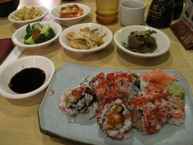 Spicy spider roll and five Korean side dishes