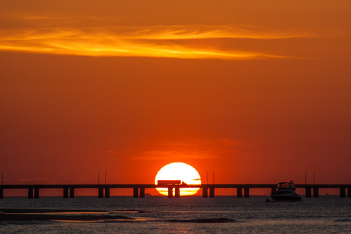 bridge sunset red sky orange sun beach clouds truck golden evening bay boat sand surf crossing dusk silhouettes vehicle bayside setting virginiabeach oceanpark lastlight chesapeakebay bayfront chesapeakebaybridgetunnel cbbt lynnhaveninlet