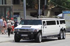 hummer h2(0.0), automobile(1.0), sport utility vehicle(1.0), vehicle(1.0), land vehicle(1.0), luxury vehicle(1.0), limousine(1.0), motor vehicle(1.0),