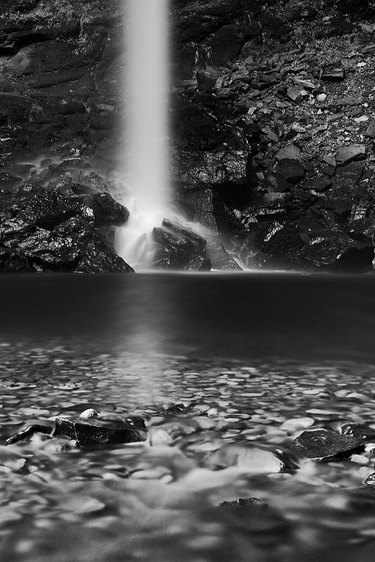 A black and white landscape image of Hardraw Force waterfall, taken in the Yorkshire Dales