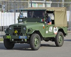 off-roading(0.0), jeep cj(0.0), automobile(1.0), automotive exterior(1.0), military vehicle(1.0), sport utility vehicle(1.0), vehicle(1.0), off-road vehicle(1.0), bumper(1.0), land vehicle(1.0), motor vehicle(1.0),
