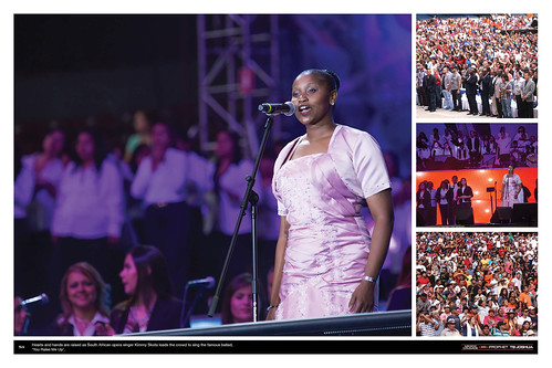 Hearts and hands are raised as South African opera singer Kimmy Skota leads the crowd to sing the famous ballad, 'You Raise Me Up'.