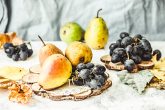 Fresh blue grapes and pears, autumn raw fruits