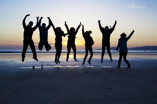 sunset sea sky beach jumping group silouhette