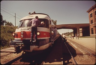 Turboliner engine's windshield is cleaned as the passenger train is stopped at Bloomington, Illinois, enroute from St. Louis Missouri, to Chicago, June 1974