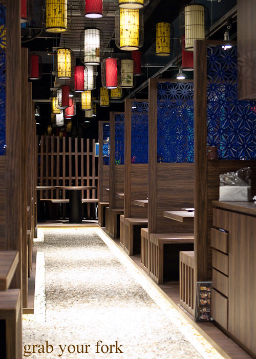 Booths and lantern decor inside Lantern by Wagaya Sydney