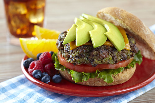 Beef burger with black beans and avocado.