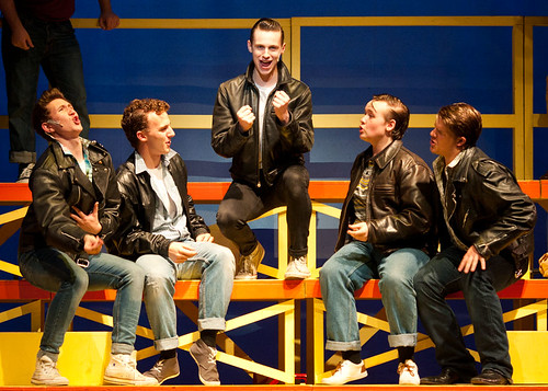 Danny and the gang on the bleachers  in the Stage Experience production of Grease at the Edinburgh Playhouse. Photo credit: <a href=