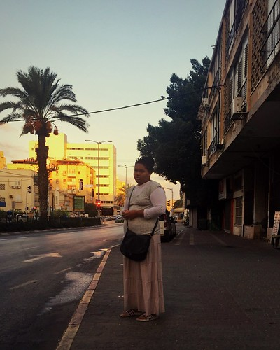 streetphotography woman sunrise fulllength rearview architecture road street buildingexterior builtstructure tree palmtree clearsky city casualclothing outdoors sky day thewayforward citylife hobbies