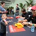 Helio Castroneves signs an autograph for a young fan