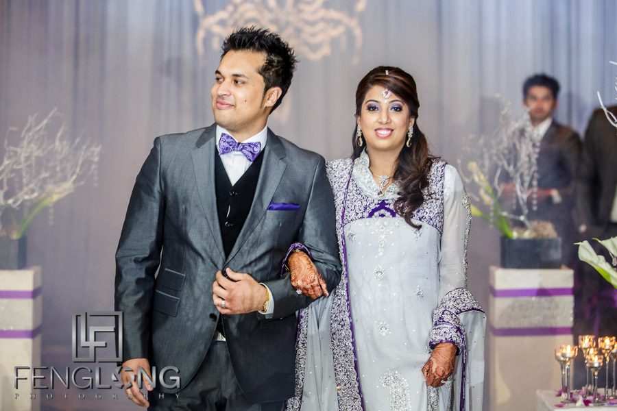 Bride and groom make their entrance to the Indian wedding reception