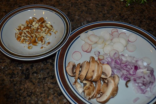 Sliced mushrooms, radishes, onions and pecan pieces