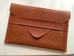 orange(0.0), wood(0.0), leather(0.0), box(0.0), brand(0.0), rectangle(1.0), brown(1.0), wallet(1.0),