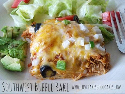 Southwest Bubble Bake with avocado, green salad and tomatoes on plate