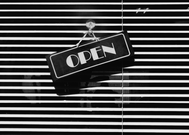 black and white photo of open sign