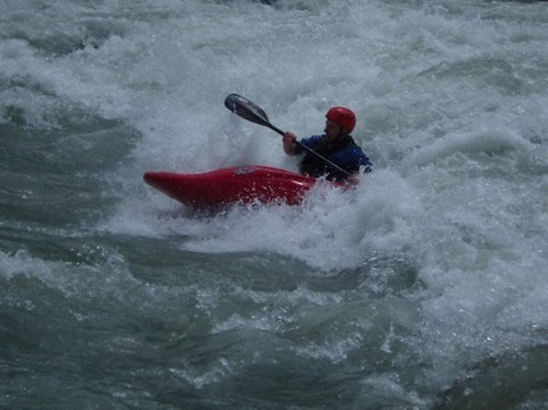 Greg surfing the Rabioux Rapid