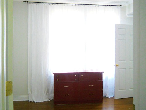 How To Disguise An Off Center Window With Curtains