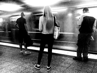 THREE WAITING SUBWAY B&W