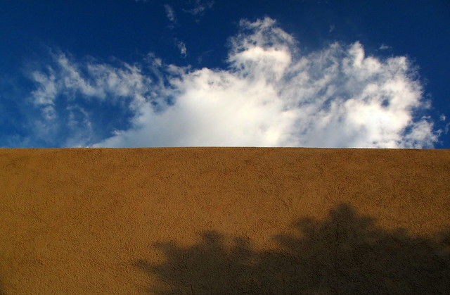 shadowed adobe & clouds