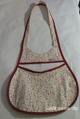 bag(0.0), shoulder bag(0.0), brown(0.0), hobo bag(0.0), handbag(0.0), design(0.0), pink(0.0), art(1.0), textile(1.0), patchwork(1.0), clothing(1.0), maroon(1.0),