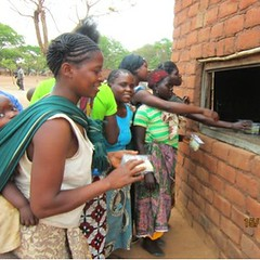 Mothers redeeming vouchers at a rural shop in Katete (square)