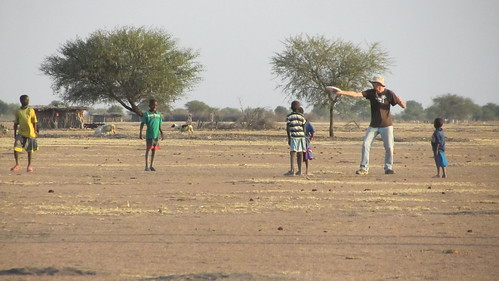 Chris teaching kids to throw a frisbee. It was a favorite last year.