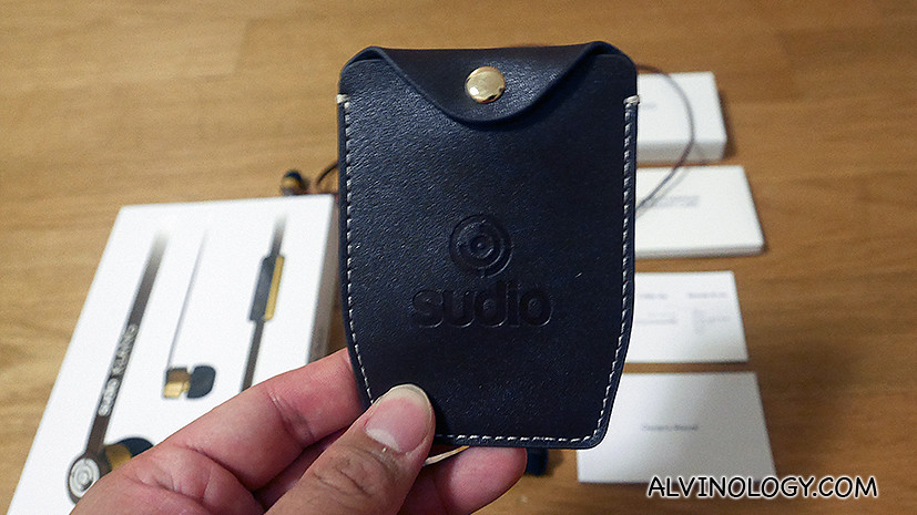 Sewn leather pouch to store the headphones