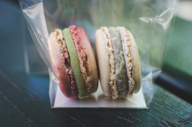Two Pierre Hermé macarons, the Infiniment Vanille and the shimmering Pistache et Griottine, an amazing flavor combination of pistachio, ceylon cinnamon and griottine cherry