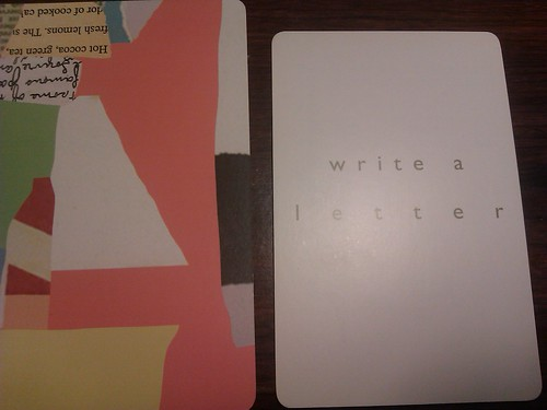 a blank white card that says 'write a letter' on it in green writing