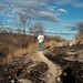Lon on a burned road - Lon en un camino quemado, cerca de Calmecac, Puebla, Mexico por Lon&Queta
