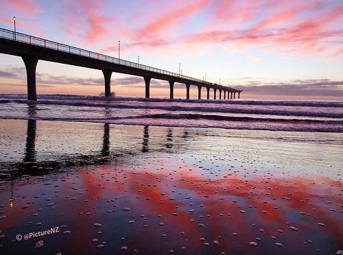 bubbles foam beach waves pacific ocean sea pier peir sand pink red sky clouds splash lights lampposts horizon newbrighton brighton christchurch canterbury southisland nz newzealand dawn sunrise landscape daybreak sunup greatphotographers stevetaylor
