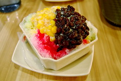 shaved ice dessert with flavored syrups, sweet corn, and beans