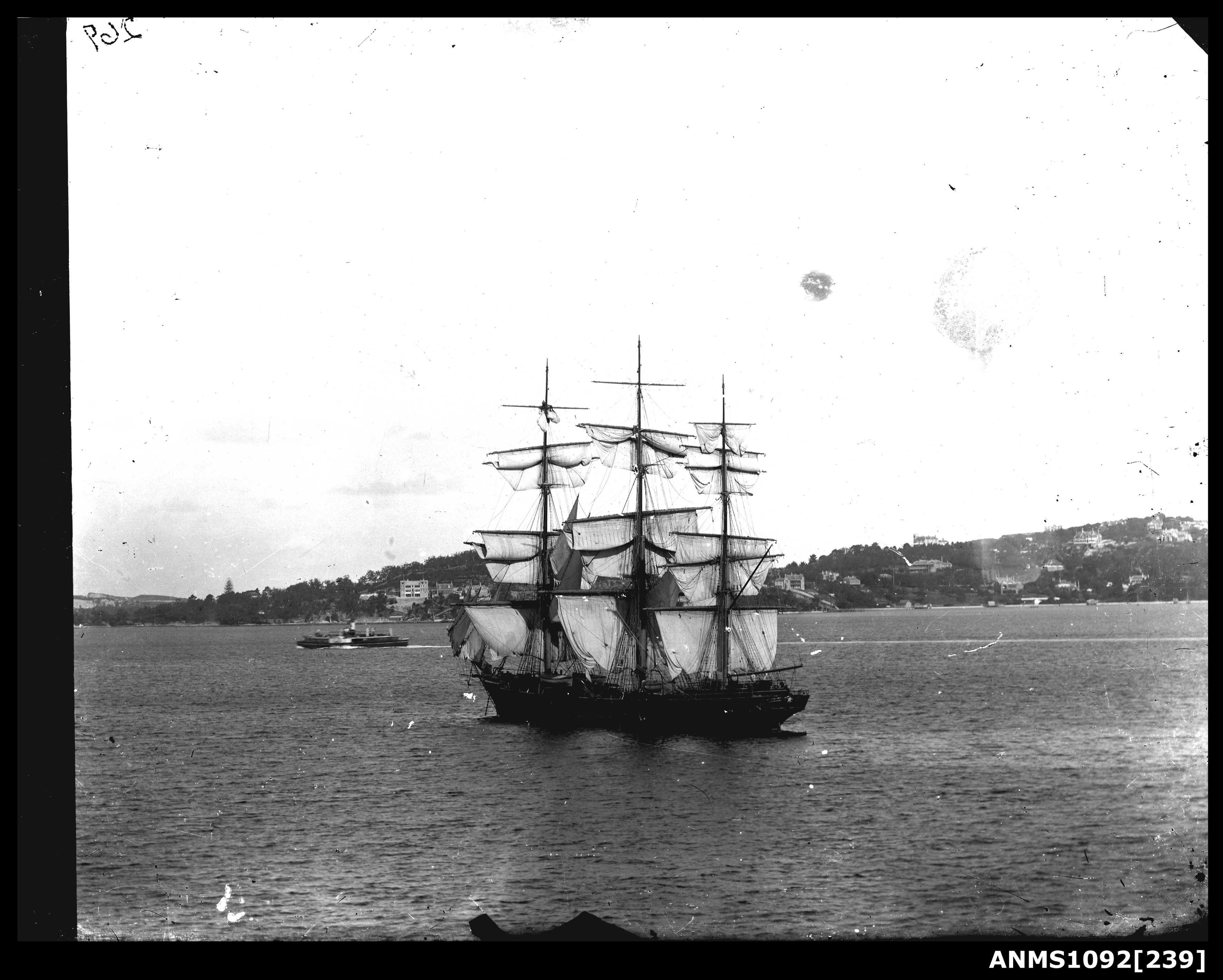 Three masted ship with unfurled sails