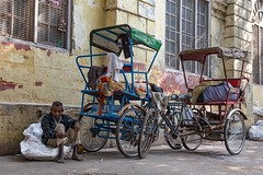 Pedicab driver taking a break in Delhi, India. #travel #india #streetphotography