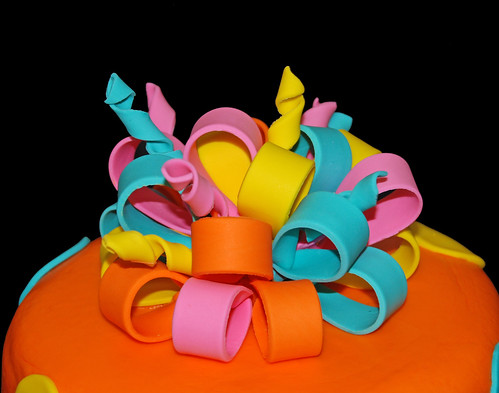 orange yellow pink and aqua fondant bow