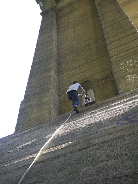 climbing the underside of a bridge