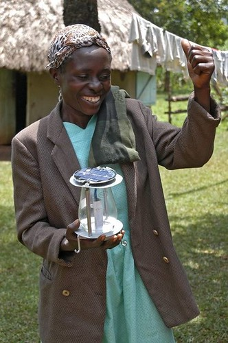 a happy woman with Mwangabora lamp
