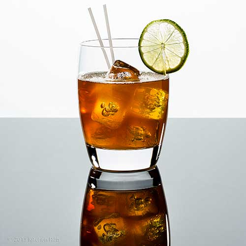 Dark and Stormy Cocktail in rocks glass with lime garnish